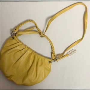 Nine West Yellow pouch bag.